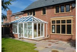 Conservatory with folding sliding doors