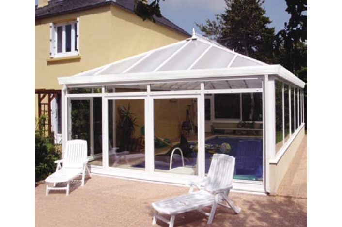 Double hipped Edwardian swimming pool enclosure. Roof is fitted with optional Cornice eaves upgrade.