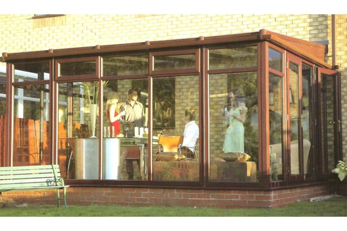 Low pitch Lean to conservatory with full height glass