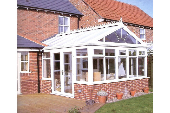 White Gable End conservatory with partial box gutter and sunburst gable front