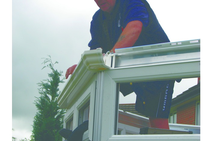 The guttering is fitted into position including any down pipes.