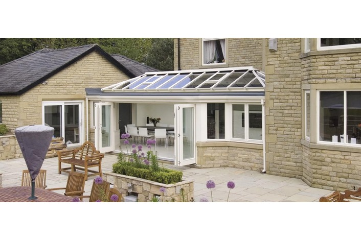 Cream conservatory with folding doors