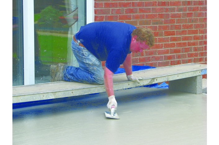 The concrete is floated to produce a smooth floor level.