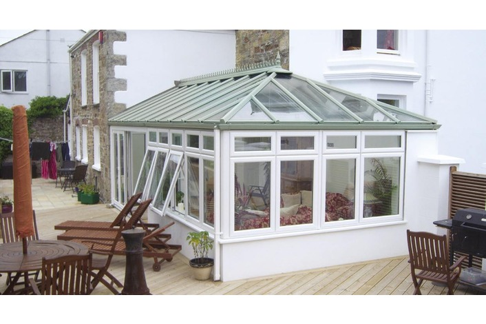 White Edwardian conservatory with Chartwell Light Green Roof