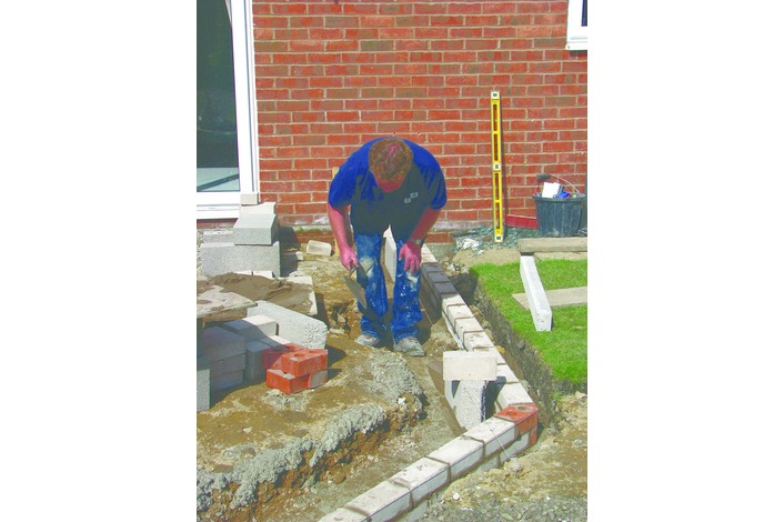 The external skin of the cavity wall is built to just below outside ground level.