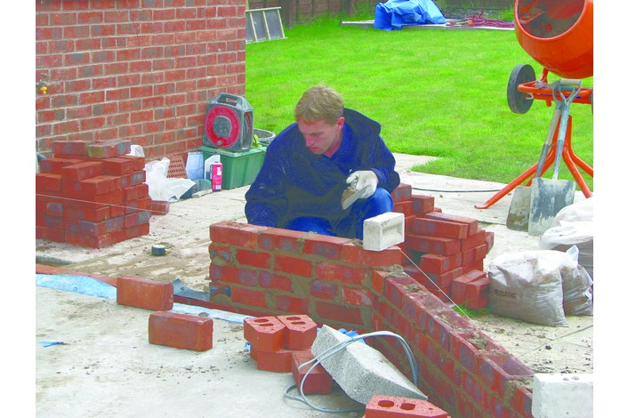 Using bricks to match the existing house brickwork the remaining dwarf walls for the conservatory are constructed in accordance with the base plans.