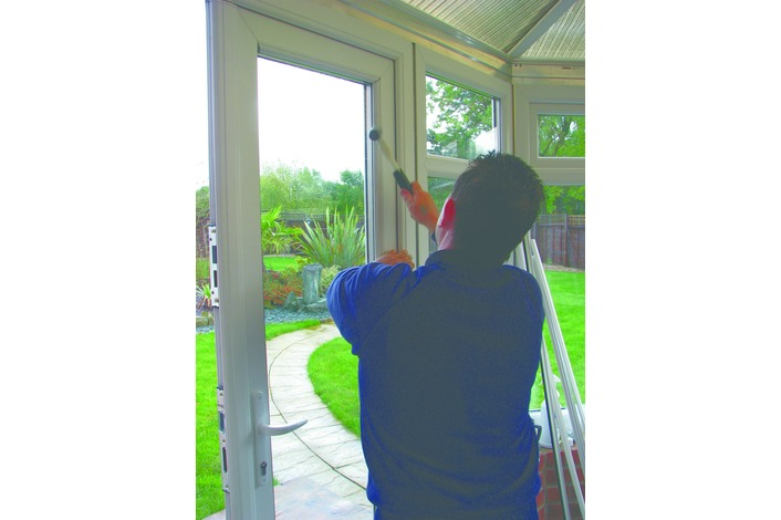 Installing the double glazed sealed units into a French door.