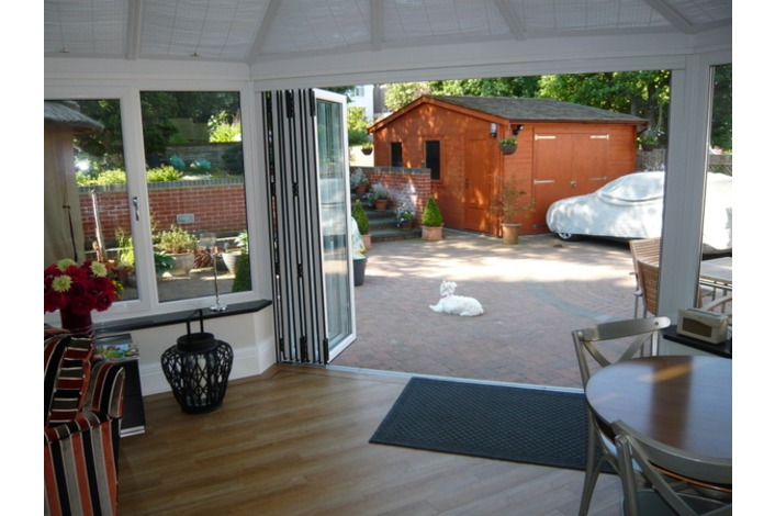 Internal view showing the use of folding sliding doors in a conservatory