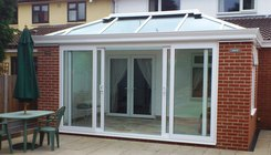 Livin room with 4 panel patio door
