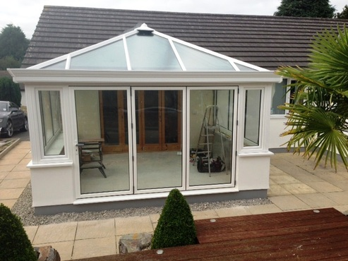 white Edwardian conservatory with bifold doors